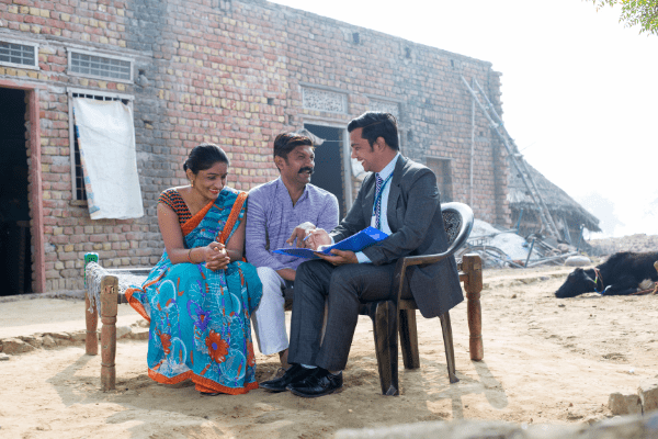 Professional talking with two villagers