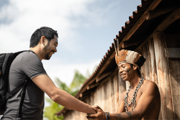 Tourist meeting and shaking hands with a local Brazilian villager